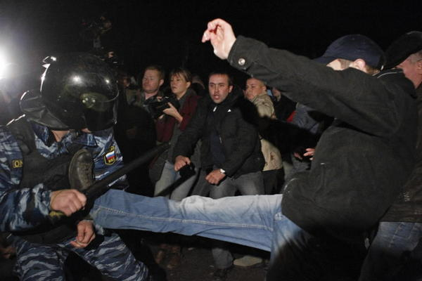 Demonstrators scuffle with police in the Biryulyovo district of Moscow October 13, 2013.