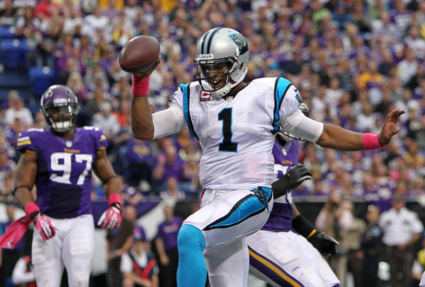 Carolina Panthers quarterback Cam Newton runs for a touchdown during the third quarter against the Minnesota Vikings.