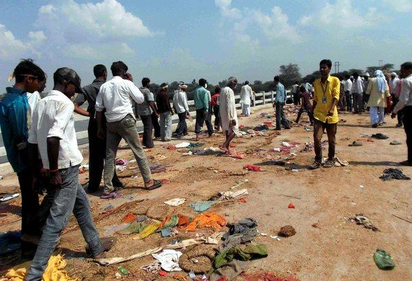 Victims' belongings lie on the ground after a stampede on a bridge over the river Sindh in India. At least 89 people died.