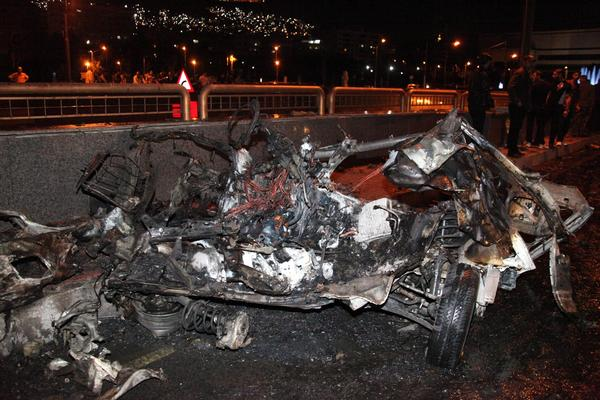 A picture released by the official Syrian Arab News Agency on Sunday shows the remains of a vehicle after two cars laden with explosives blew up in the center of the Syrian capital, Damascus, state media reported.
