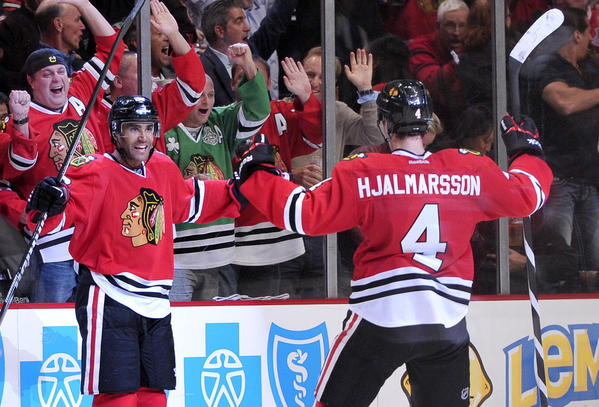 Johnny Oduya is congratulated by Niklas Hjalmarsson after scoring a goal against the Capitals during the third period.