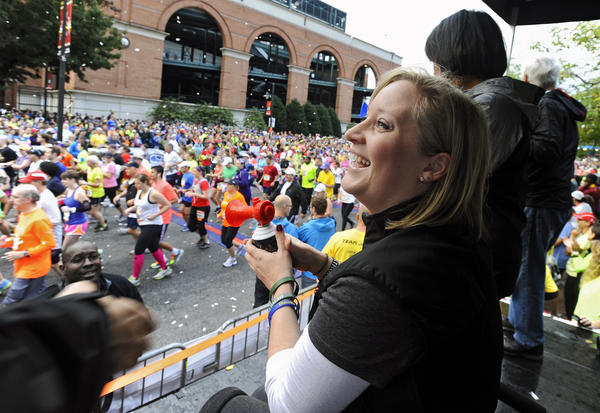 Honorary starter Erika Brannock, a survivor of the Boston Marathon terrorist bombing attack, smiles after she started the 2013 Baltimore Marathon during the 13th Annual Baltimore Running Festival.