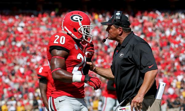 Georgia defensive end Quincy Mauger gets an earful from defensive coordinator Todd Grantham during the Bulldogs' 41-26 loss to Missouri on Saturday. The loss shattered Georgia's national title hopes.