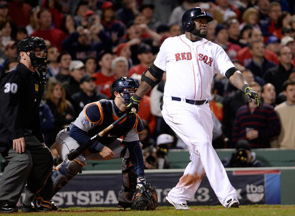 Red Sox DH David Ortiz hits a grand slam in the eighth to tie the score against the Tigers in Game 2 of the American League Championship Series.