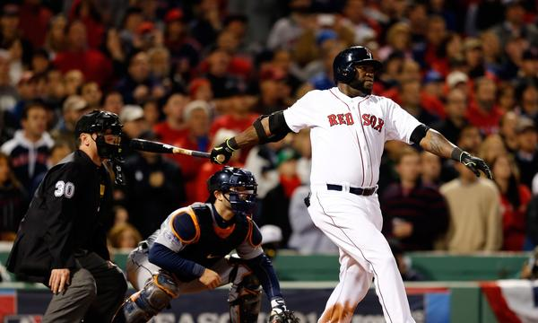 Boston's David Ortiz hits a game-tying grand slam in the eighth inning during the Red Sox's 6-5 win over the Detroit Tigers in Game 2 of the American League Championship Series on Sunday.