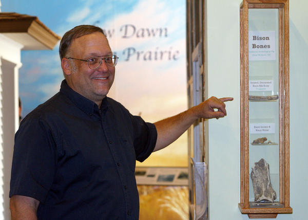 Northern State University history professor David Grettler shows a display of select bison bones that were found at the Gunderson archeology site north of Aberdeen.