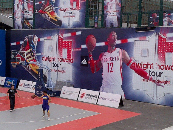 This Dwight Howard mural in China is in front of the arena the Lakers have been using to practice for an exhibition game Tuesday.