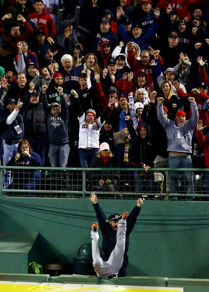 Torii Hunter of the Detroit Tigers tries to catch a grand slam hit by David Ortiz of the Boston Red Sox in the eighth inning of Game Two of the American League Championship Series.