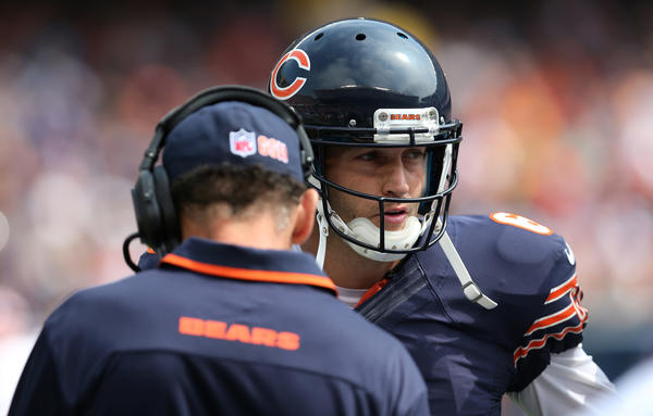 Bears quarterback Jay Cutler talks with head coach Marc Trestman.