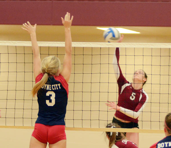 Charlevoix's Madeline Boss (right) finished with 80 kills and 41 digs in leading the Rayders to a runner-up finish Saturday at the 16-team Suttons Bay Invitational.
