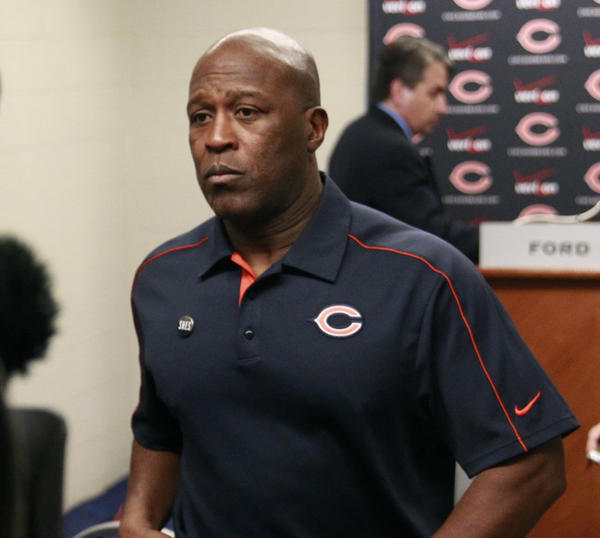 Bears coach Lovie Smith, walks away from the podium after his final Bears news conference last Dec. 30.