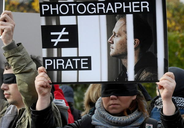 Photojournalists rally in support of their jailed colleague Denis Sinyakov in Russia's second city of Saint Petersburg, on October 13, 2013.