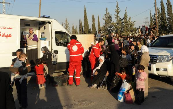 Women and children arrive to be evacuated from a Damascus suburb by the Syrian Arab Red Crescent.