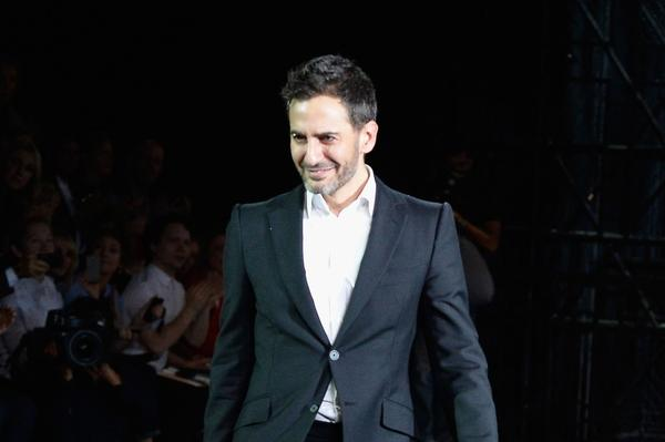 Fashion designer Marc Jacobs acknowledges applause following the Louis Vuitton show as part of the Paris Fashion Week Womenswear Spring/Summer 2014 at Le Carre du Louvre in Paris, France.