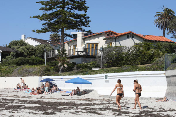 Mitt Romney plans to tear down his beachfront house in La Jolla and build a much larger one, including a car elevator. Neighbors' feelings are mixed.