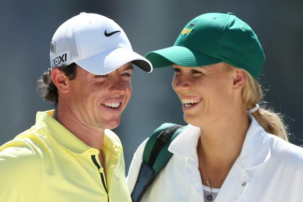 Caroline Wozniacki caddies for Rory McIlroy during the Par 3 Contest prior to the start of the 2013 Masters Tournament at Augusta National in April.