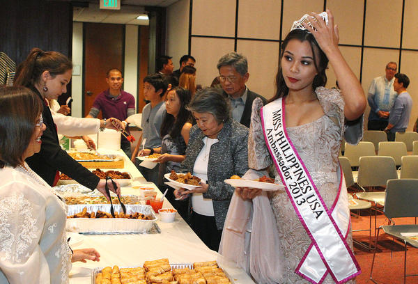 Miss Philippines USA Ambassador 2013 Camille Teodoro, of Los Angeles, at a celebration of Philippine Heritage - Arts and Culture at the Glendale Library on Friday, October 11, 2013. Several certificates were given, food served, and arts displayed at the event, attended by about 60 people.