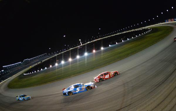 Drivers compete during the 2013 NASCAR Sprint Cup Series Geico 400 at Chicagoland Speedway on Sept. 15/
