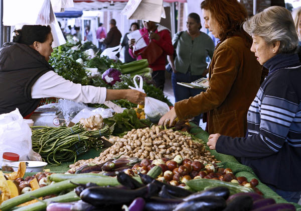 People shop for fresh vegetables and fruits at the downtown Farmers Market on Brand Blvd. in Glendale on Thursday, Oct. 10, 2013. The city of Glendale is looking into the possibility of handing over the operation of the Farmer's Market to the Downtown Glendale Association.