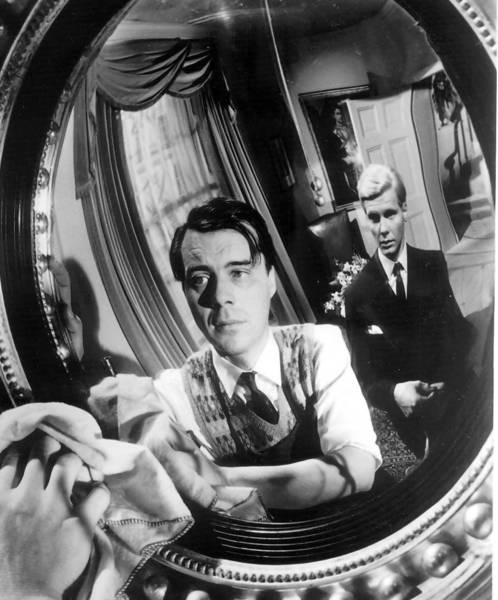 "Dirk Bogarde (in mirror) and James Fox in ""The Servant."""