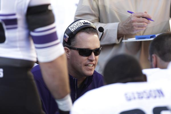 Head Coach Pat Fitzgerald of the Northwestern Wildcats talks to the defense on the sidelines during the game against the Wisconsin Badgers.