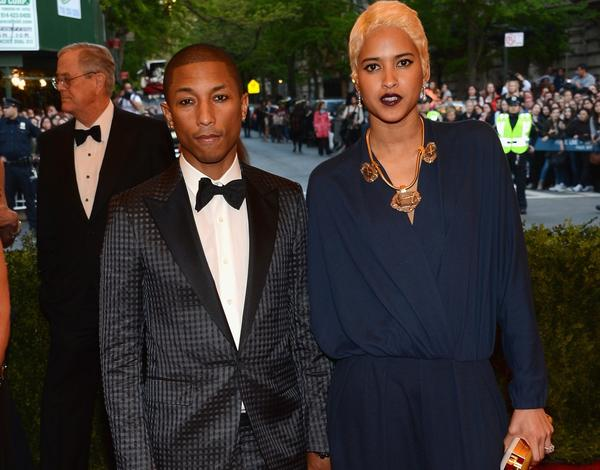 "Pharrell Williams and Helen Lasichanh attend the Costume Institute Gala for the ""PUNK: Chaos to Couture"" exhibition at the Metropolitan Museum of Art in New York."