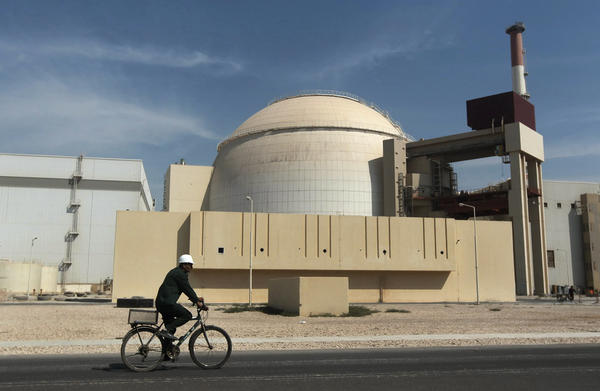 A worker makes his way in front of the reactor building at the Bushehr nuclear power plant in Iran.