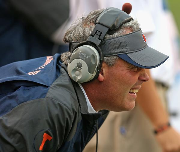 Head coach Tim Beckman of the Illinois watches as his team takes on the Washington Huskies at Soldier Field.