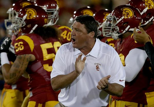 Ed Orgeron led USC to a 38-31 victory over Arizona in his first game as interim head coach.