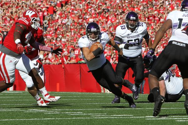 Northwestern quarterback Kain Colter is day to day after injuring his ankle against Wisconsin.