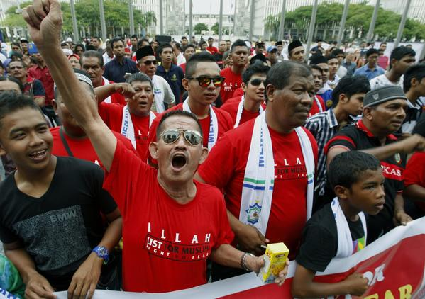 Malay Muslims in Putrajaya, outside Kuala Lumpur, cheer an appeals court decision that only the Islamic deity can be referred to as Allah. A Christian newspaper had challenged a 2008 ban on non-Muslims using the name Allah for their god, as has been the practice in the region for more than a century.