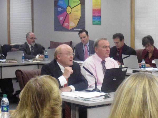 Naperville North Principal Kevin Pobst, left, and Naperville Central Principal Bill Wiesbrook give the Naperville Unit District 203 school board an update on their new academic integrity policy.