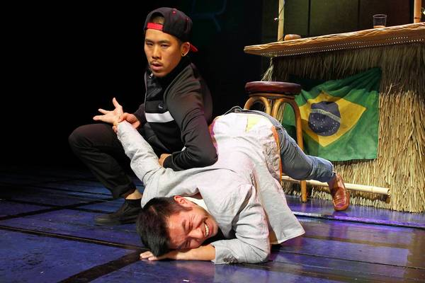 "Lawrence Kao, left, and Nelson Lee in the South Coast Repertory production of ""Fast Company."""