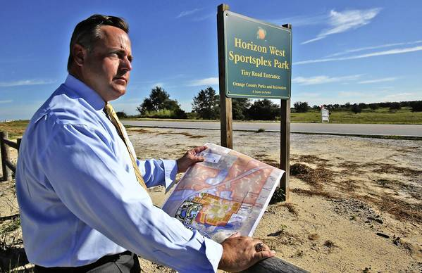S. Scott Boyd District 1, Orange Couny Commisioner holds a map of a proposed Horizon Sportsplex Park in west Orange County. Boyd is rushing to get his sportsplex in place before the vote on the publicly-subsidized stadium comes to a final vote later this month.