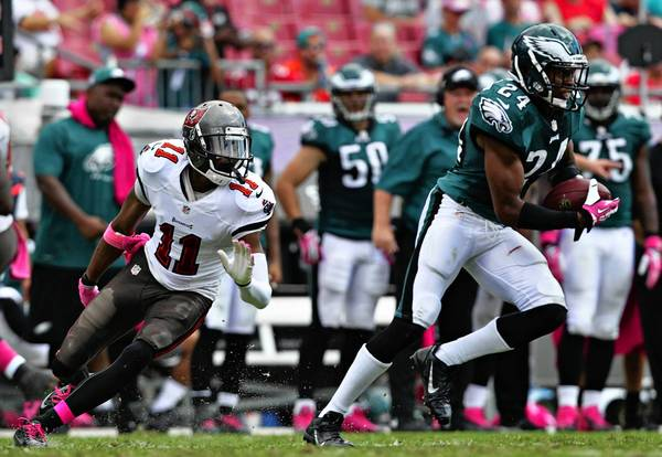 Eagles cornerback Bradley Fletcher (24) picks off a pass in the third quarter against Tampa Bay.