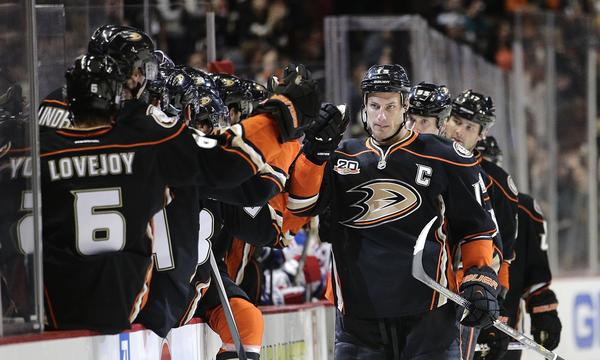 Ducks captain Ryan Getzlaf, right, is congratulated by his teammates after scoring in a win over the New York Rangers on Thursday. The Ducks point to their fast-paced playing style as one of the reasons behind their impressive start.