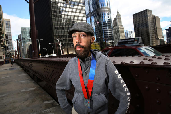 Maickel Melamed, 38, from Venezuela, poses for a photo on the State Street bridge in Chicago. Melamed, who has a rare condition that limits his muscular strength, walked the Bank of America Chicago Marathon in 16 hours and 46 minutes.