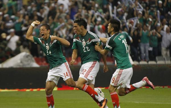 Mexico's Raul Jimenez, center, celebrates with teammates Javier Hernandez, left, and Oribe Peralta after scoring a game-winning goal against Panama on Friday. Mexico likely will qualify for the World Cup with a win over Costa Rica on Tuesday.