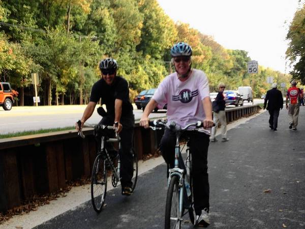 Mike Burns, a retired lieutenant with the Wheeling Fire Department, and his wife Kathy, ride the Phyllis Harmon Path along Dundee Road.