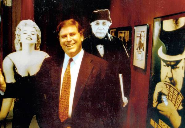 Roger Richman in his office in 1993 with images of clients W.C. Fields and Marilyn Monroe. Richman was instrumental in getting the 1985 California Celebrity Rights Act passed.