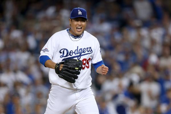 Dodgers starter Hyun-Jin Ryu gets pumped up after a strikeout in the seventh inning of Game 3 of the NLCS.