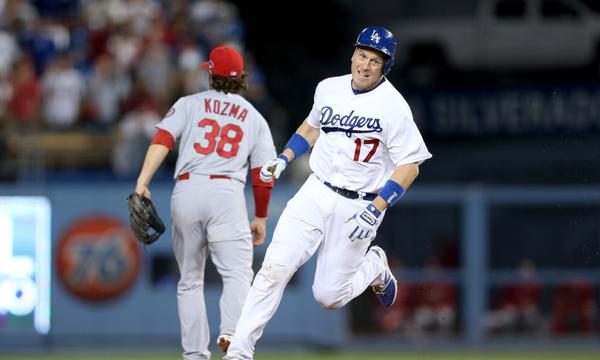 Dodgers catcher A.J. Ellis rounds second base on his way to a triple in the Dodgers' 3-0 win over the St. Louis Cardinals in Game 3 of the National League Championship Series on Monday. Ellis was rewarded for his faith in third base coach Tim Wallach on the hit.