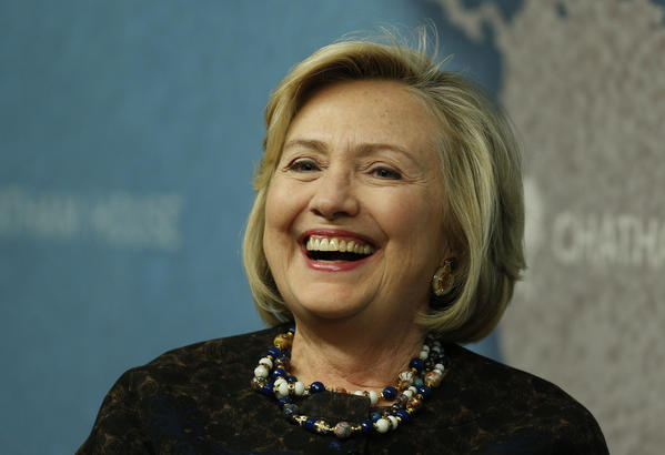 Former Secretary of State Hillary Rodham Clinton laughs as she arrives for an event at Chatham House in London.