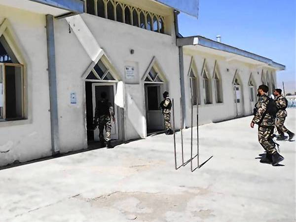 Afghan security forces inspect the entrance gate of a mosque where Logar governor Jamal was killed by a bomb blast in Logar province.