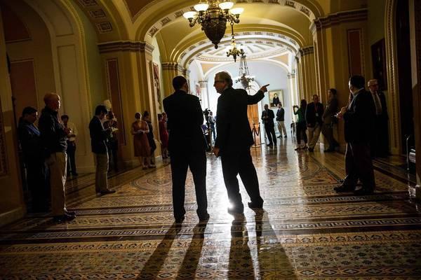 Reporters wait for senators in the Capitol building.