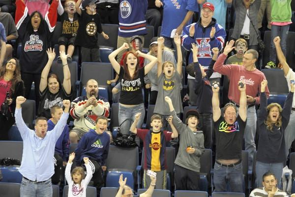 Fans react after officials declare Wolfpack tying goal good with .4 seconds left in this year's opening season game against the Admirals.