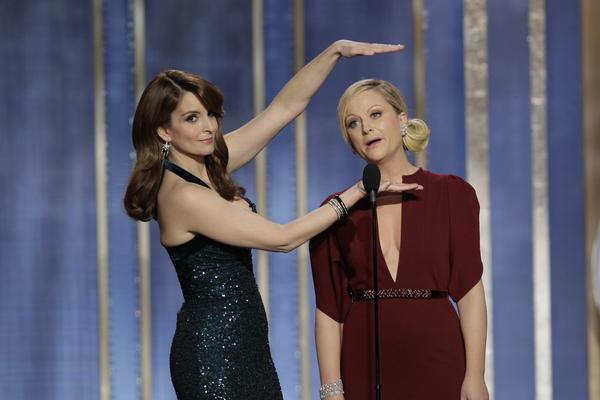 Hosts Tina Fey, Amy Poehler on stage during the 70th Annual Golden Globe Awards.