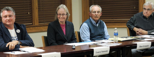 Boyne City commission candidates (left), Don Ryde, Laura Sansom, Ron Grunch and Gene Towne, answer questions at the candidate forum, Monday, Oct. 14, 2013 at the Boyne City Public Library.