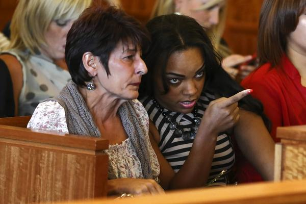 Aaron Hernandez's fiance Shayanna Jenkins, right, with his mother, Terri, during Hernandez's arraignment in the Bristol County Superior Court in Fall River, Mass.