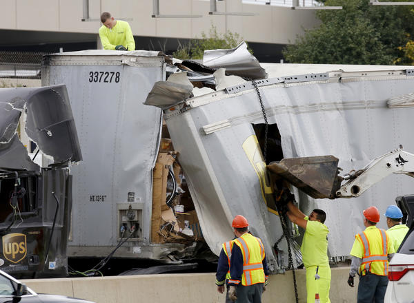A UPS truck crashed westbound on the Reagan Tollway (I-88) at Route 83 crashed, smashing open its trailer and spilling hundreds of packages on Tuesday in Oak Brook.